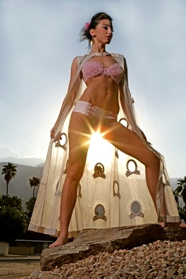 woman standing posed so the sun shines through her thighs